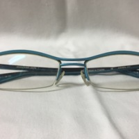 11.  A pair of medium rectangular blue metal glasses with a brown stripe on top.