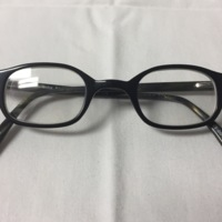 15.  A pair of medium rectangular black plastic glasses.