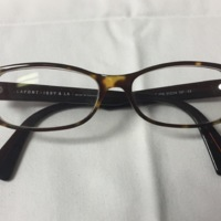9.  A pair of medium rectangular brown & yellow mottled plastic glasses.