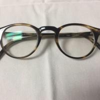 13.  A pair of small circular brown & yellow mottles glasses.