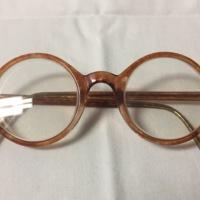 16.  A pair of medium circular orange plastic glasses.