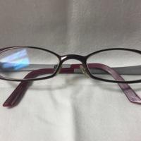 2.  A pair of medium rectangular purple and silver metal glasses.