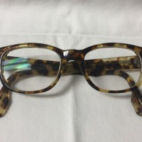 8.  A pair of large round brown & yellow mottled plastic glasses.