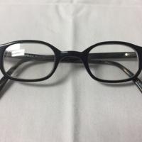 15.  A pair of medium rectangular black plastic glasses.