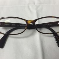 9.  A pair of medium rectangular brown & yellow mottled plastic glasses.