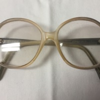 7.  A pair of large round pale-yellow plastic glasses.